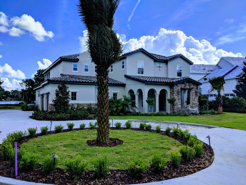Driveway completed with pavers and landscaped exterior view of new home currently being built in Central Florida and available for sale.