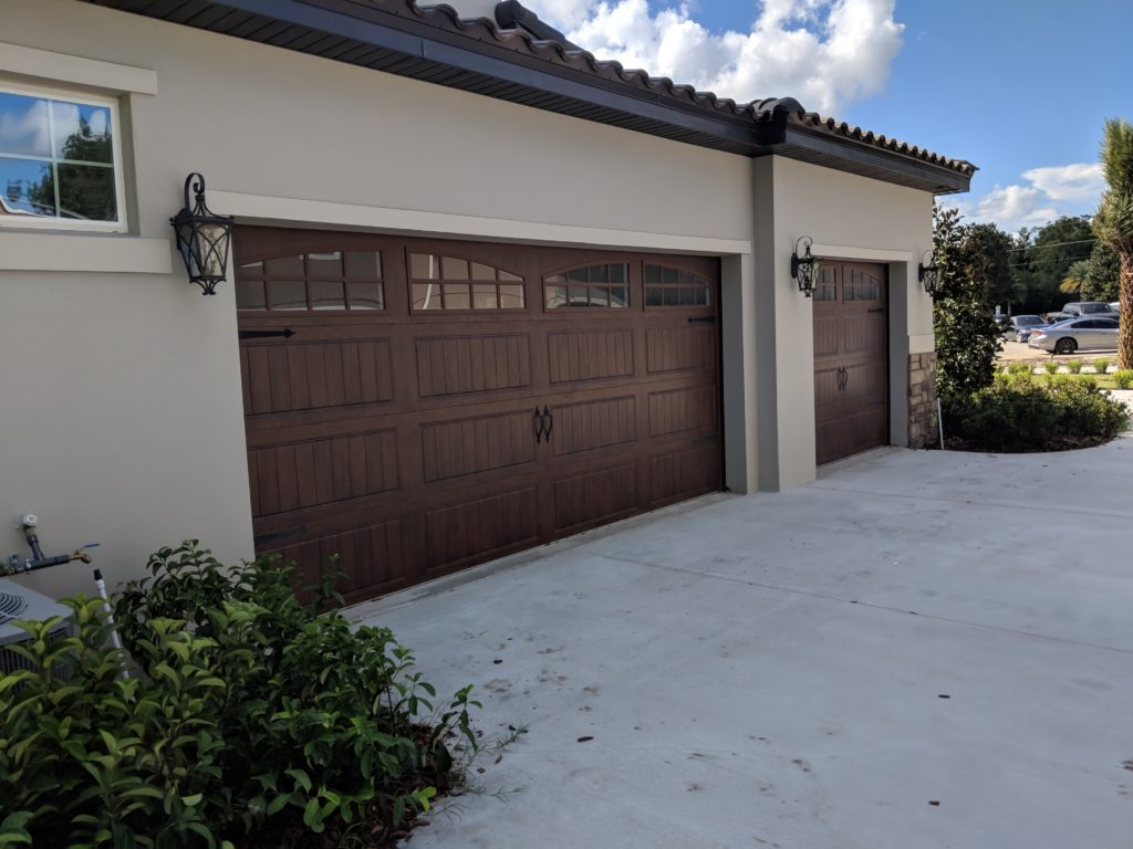 Spacious garage with two openings, completed driveway and lighting to compliment new home at gorgeous Lake Mary in Central Florida.
