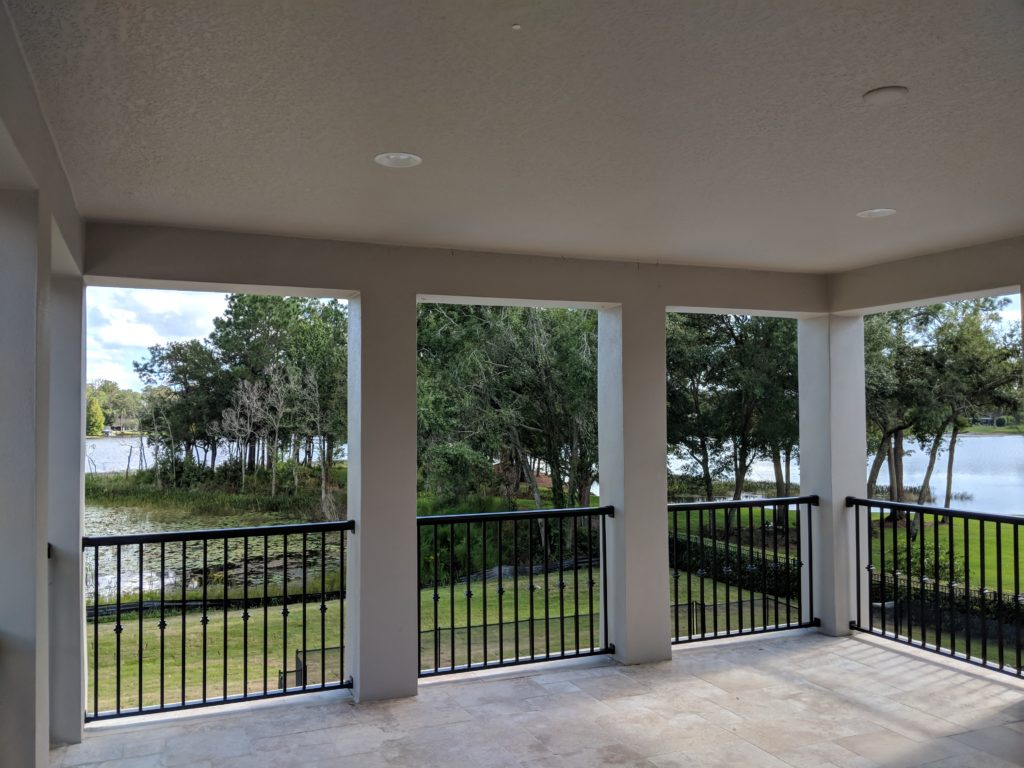 View of waterfront property at Lake Mary currently being built with gated outdoor living area.