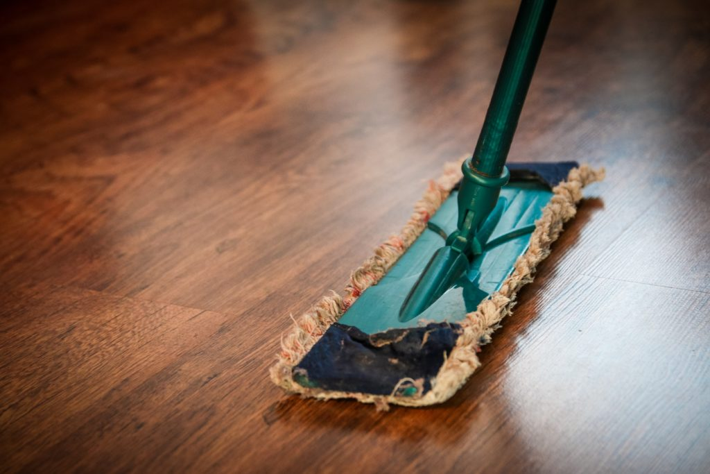 Making sure your home is clean by mopping the floors will attract buyers when trying to sell your home to buy a new home.