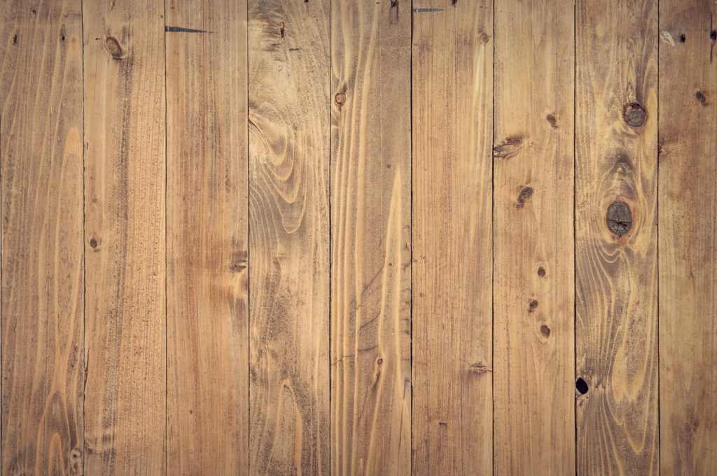 Brown slats of wood flooring as an example of a type of floor you can choose with a new home by Avex Homes in Central Florida.